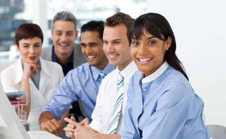 A diverse business group sitting in a line Stock Photo - 10256517