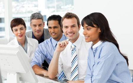 International business group sitting in a line Stock Photo - 10259384