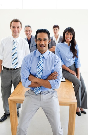 Cheerful International Business partners standing around a table Stock Photo - 10258598