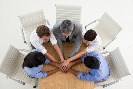 Multi-ethnic business people with hands together  photo