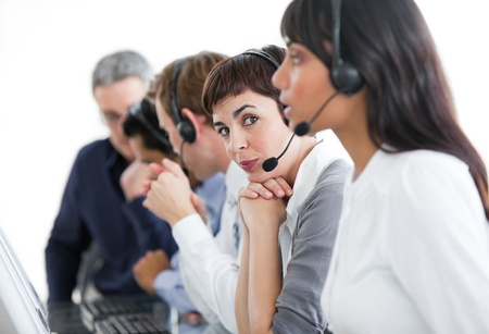 Charming businesswoman with headset on in a call center  photo