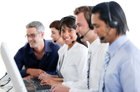 Cheerful business people working in a call center Stock Photo - 10256017