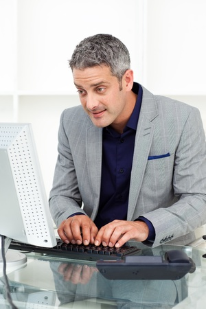 Concentrated businessman working at a computer  photo