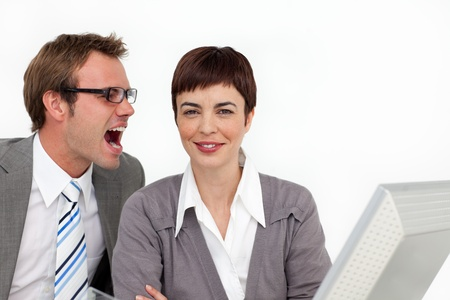 Young businessman shouting into his colleagues ear  photo
