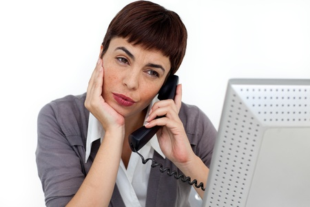 Attractive Businesswoman on phone at her desk  photo
