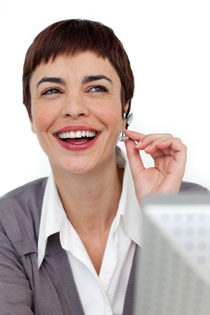 Laughing businesswoman with headset on  photo