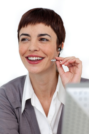 Self-assured businesswoman with headset on photo