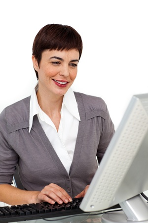 Self-assured businesswoman working at her computer  photo