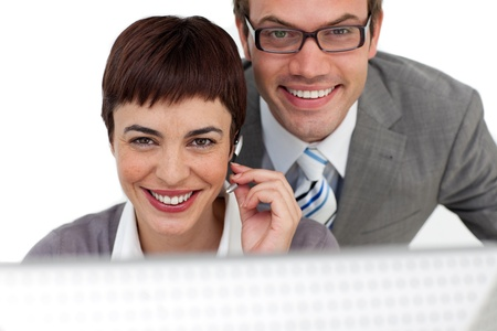 Confident business people working together at a computer  Stock Photo - 10258781