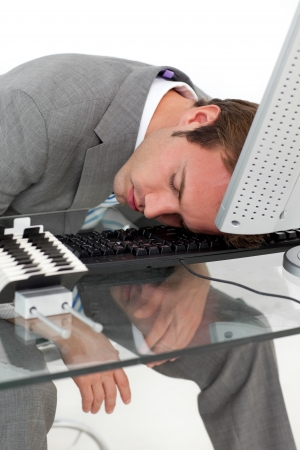 Tired businessman sleeping on his desk Stock Photo - 10238998