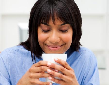 Happy businesswoman drinking a coffee Stock Photo - 10256581