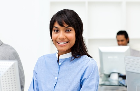 Attractive ethnic businesswoman working at a computer  photo