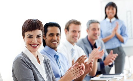 Multi-ethnic business people clapping a good presentation  photo