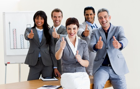 Successful business people with thumbs up Stock Photo - 10258623