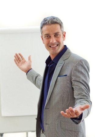 Charming businessman pointing at a board  photo