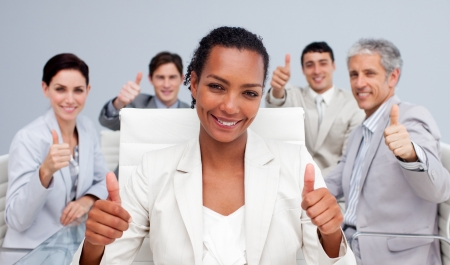 sucess: Happy business team celebrating a sucess with thumbs up