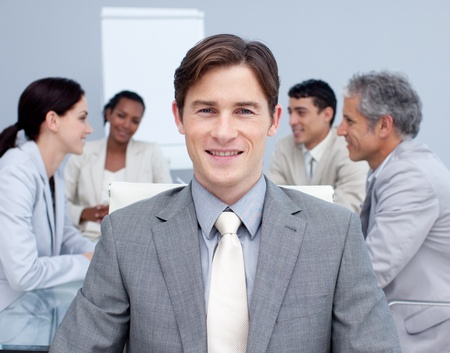 Close-up of a smiling young businessman in a meeting photo