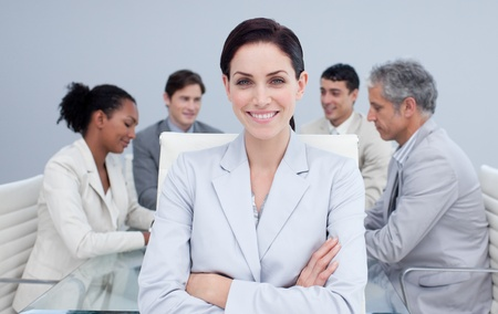 Confident businesswoman smiling in a meeting photo