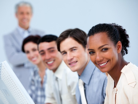 Young business partners with their senior manager Stock Photo - 10241545