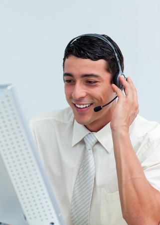 customer service representative: Latin businessman talking on headset