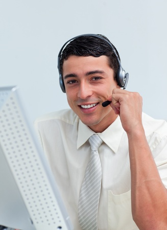 Assertive businessman talking on headset  photo