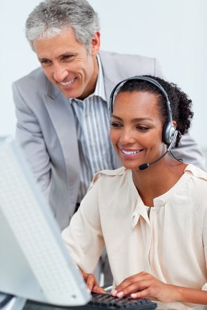 Diverse business partners working at a computer photo