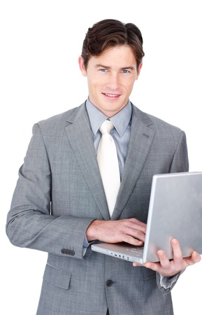 Charming businessman using a laptop  photo