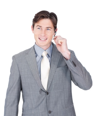Smiling young businessman using headset  photo