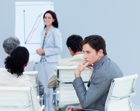 training consultant: Bored young businessman at a presentation Stock Photo