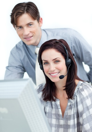 Brunette businesswoman helping by her manager Stock Photo - 10258443