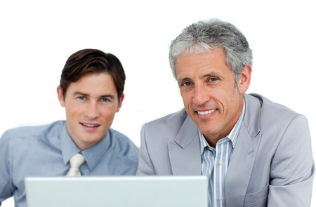 assertive: Assertive business partners working at a computer  Stock Photo