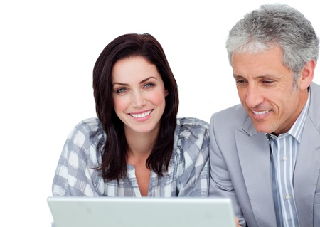 assertive: Two positive business co-workers using a laptop  Stock Photo