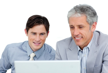 Concentrated business co-workers using a laptop Stock Photo - 10256175