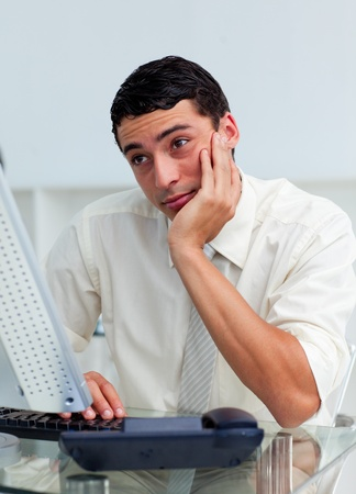 Bored latin businessman at his desk Stock Photo - 10242222