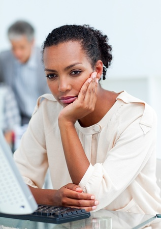 Bored businesswoman at her desk Stock Photo - 10258713