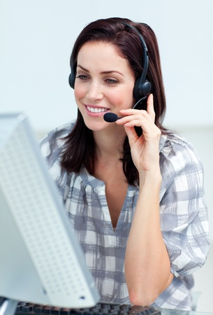 Caucasian smiling businesswoman with headset on  photo