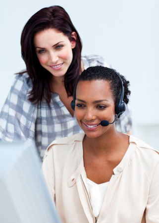 Confident businesswoman with headset on Stock Photo - 10258653