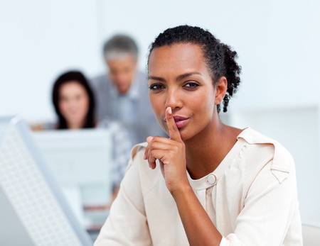 Confident businesswoman asking for silence photo