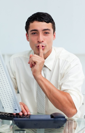Young businessman asking for silence  photo