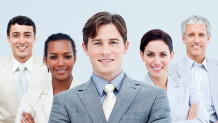Multi-ethnic business partners standing with folded arms photo