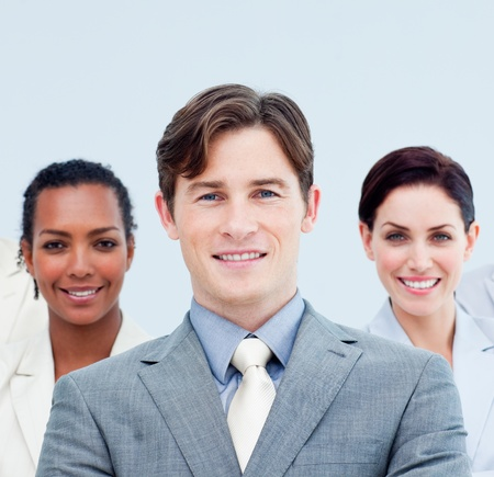 Smiling business people standing with folded arms  photo