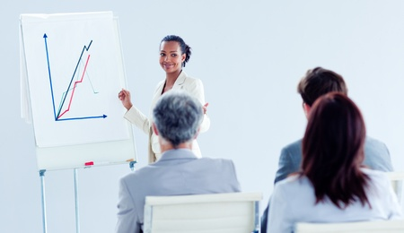 Smiling ethnic businesswoman doing a presentation  photo