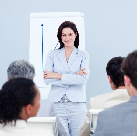 Positive businesswoman doing a presentation photo