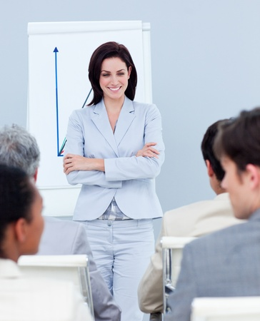 Charming businesswoman doing a presentation Stock Photo - 10244229