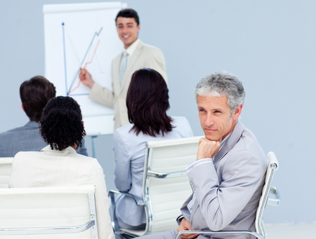 training consultant: Charming businessman looking at the camera at a conference