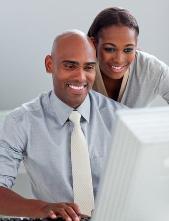 Confident business partners working at a computer together  photo