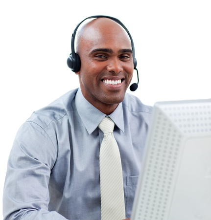 Happy businessman talking on headset at a computer  photo