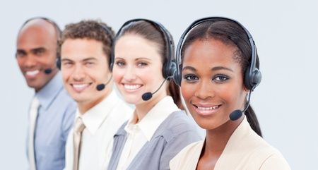 Smiling business team with headset on photo