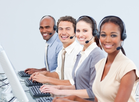 international sales: Confident business people working in a call center