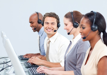 Cheerful business people with headset on  photo